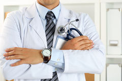 Male medicine therapeutist doctor hands crossed on his chest Stock Image
