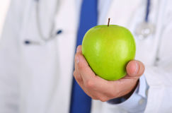 Male medicine therapeutist doctor hands holding green fresh ripe Stock Photo