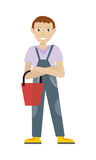 Male Member of Cleaner Service Staff in Uniform. Cleaning service. Male member of the cleaner service staff in uniform with bucket. Worker of cleaning company Royalty Free Stock Photo