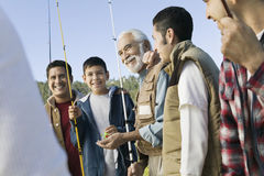 Male Members With Fishing Rods Smiling Stock Images