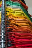 Male Mens Shirts on Hangers on a Shop Wardrobe Closet Rail Stock Photo