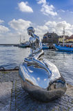 The male mermaid statue. Called Han standing on March 10, 2015 in the harbour of Elsinore, Denmark stock images