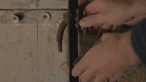 Male metal key unlocks the padlock, opens the wooden door and enters. Door, key, wood, master  rusted mechanical metal door lock 4K stock video