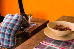Male in a Mexican bar got drunk and fell asleep sitting alone. On a chair at the table stock images