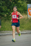 Male middle-aged athlete runs through the Park Royalty Free Stock Image