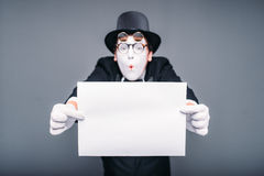 Male mime actor with empty paper sheet Royalty Free Stock Photo