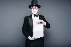 Male mime actor with empty paper sheet Stock Photography