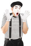 Male mime artist gesturing with his hands excitement. Isolated on white background Stock Images