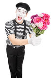 Male mime artist holding a bouquet of flowers Stock Photos