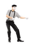 Male mime artist performing pulling virtual rope Royalty Free Stock Photos