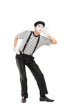 Male mime artist trying to hear something Royalty Free Stock Photo