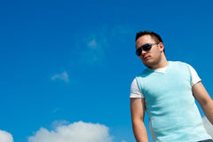 Male Model. A young fashion model against a clear blue sky Stock Image