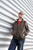 Male model. Young caucasian male model in sunglasses posing against metallic background Royalty Free Stock Photo