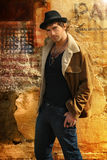 Male Model. Stylish trendy male fashion model against old wall Royalty Free Stock Images
