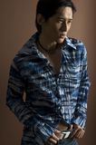 Male Model 17. An asian male model in a patterned blue shirt Stock Photos