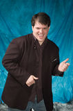 Male model. Young overweight man posing in front of portrait backdrop Stock Photo