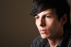 Male Model. Moody dark close-up portrait of young good looking male model Stock Image