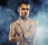 Male model against dark  background Royalty Free Stock Photography