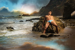 Male model on beach Stock Photo