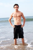 Male model on beach Royalty Free Stock Photo