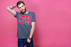 Male model with beard on a bright background Royalty Free Stock Image