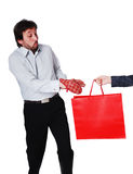 Male model carefully taking the hot bag Royalty Free Stock Images