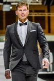 Male model on catwalk wearing bridegroom suit Stock Image