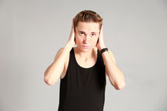 Male model covering ears with hands Royalty Free Stock Photo