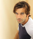 Male model face. Portrait of a casual good looking male model with striking blue eyes Royalty Free Stock Image
