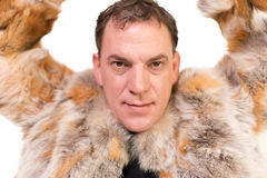 Male model and fur coat Stock Images
