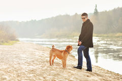 Male model with his dog outdoor Stock Photography