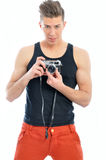 Male model is holding the camera Royalty Free Stock Photos