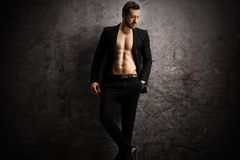 Male Model In Black Suit Posing Shirtless Stock Photo