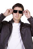Male model with jacket and sunglasses Royalty Free Stock Photo
