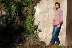 Male model leaning against wall Stock Photos