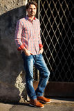 Male model leaning against wall Royalty Free Stock Photo