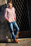 Male model leaning against wall Royalty Free Stock Photos
