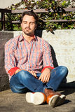 Male model leaning against wall Royalty Free Stock Image