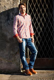 Male model leaning against wall Stock Photo