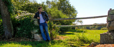 Male Model leaning on a stone wall. Stock Photography