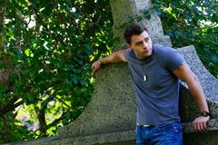 Male Model leaning on a stone wall. Royalty Free Stock Photos