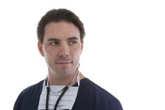 Male model in Medical Scrubs. Over white background Royalty Free Stock Images