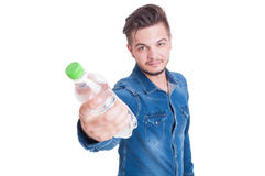 Male model offering bottle of cold water Stock Photos