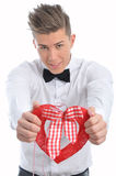 Male model offers a heart symbol on valentine's day Stock Images
