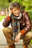 Male model outdoors. Young handsome man with nice smile in casual clothing outdoors Royalty Free Stock Image