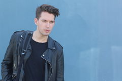 Male model portrait wearing leather jacket Stock Photos