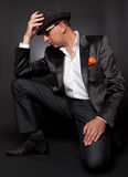 Male model poses in suit. With his fedora Royalty Free Stock Photography