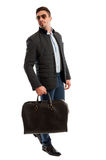 Male model posing as a business man ready for travelling Royalty Free Stock Image