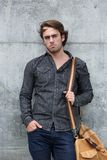 Male model posing with leather travel bag Stock Image