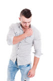 Male model posing and touching the shirt collar Royalty Free Stock Photos